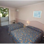 A photo of Palm Court Motor Inn accommodation - BookinDirect
