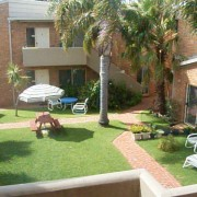 A photo of Fronds Holiday Apartments accommodation - BookinDirect